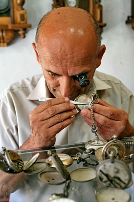 A watchmaker at work.  The watchmaker's craft uses a degree of fine motor control and hand-eye coordination which is unprecedented in the animal kingdom (Image: Wikimedia Commons)