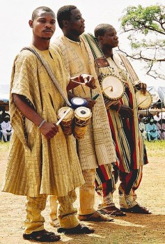 Our mode of communication is adaptable to our context.  The Yoruba from west Africa traditionally use 'talking drums' to communicate with villages up to 5 miles away.  The pitch of these drums can be varied when played, mimicking words from the Yoruba language, which is based on tonal shifts (Image: Wikimedia Commons)