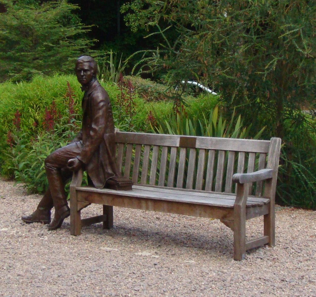 Bronze sculpture of Charles Darwin as a young man by Anthony Smith. The sculpture, which was unveiled in 2009, is located in the grounds of Christ's College, Cambridge (Image: Used with the kind permission of the Master and Fellows of Christ's College, Cambridge)