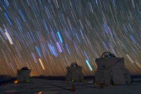 These bright colour trails mark the tracks of stars, caused by the rotation of the earth.  This time-lapse photograph was taken from the European Southern Observatory's Paranal station in the high Andes, far away from any light pollution. These natural colours indicate differences in temperature; the reddest stars are around 1000C, whist the hottest stars at several tens of thousands of degrees, appear blue (Image: ESO/B. Tafreshi (twanight.org)/Wikimedia Commons)