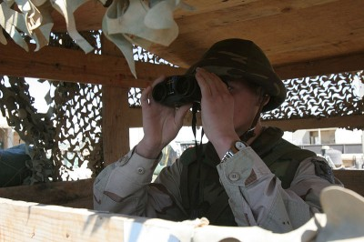At 3:25pm local time, an Azerbaijani Army soldier scans the water of Qadisiyah Lake.  Monitoring from this observation post and others along both the river and the lake side of Hadithah Dam in Iraq, is one of the measures used to guard against terrorist threats from approaching watercraft.   (Image: Wikimedia commons)