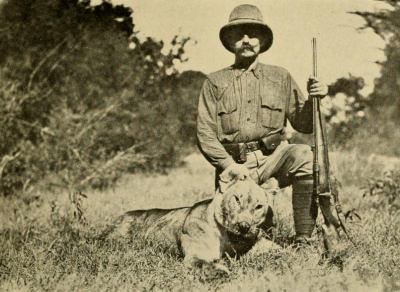 Photograph (1909) of Richard Tjader on the Sotik plains of Kenya, holding the now lifeless head of a lioness that very nearly killed him.  This image is taken from Tjader's book, 'The Big Game of Africa', published in 1910.   We respond emotionally today to things that scare us in much the same way as did our distant ancestors, avoiding lions on the savannah.   (Image: Wikimedia commons)